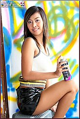 Seated On Box Holding Spray Paint Can