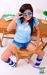 Boon Lowering Sunglasses Seated Astride Chair In Shorts