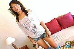 Standing Beside Sofa Wearing Denim Shorts