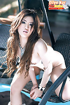 Kneeling on seat leaning forward long hair obscuring her small breasts
