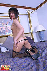 Looking Over Her Shoulder Kneeling Topless Pulling Panties Down Nice Ass Fishnet Stockings High Heels