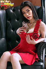 Seated On Black Leather Chair Wearing Red Dress Long Hair
