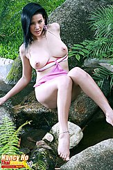 Nancy Ho Seated On Rock Topless Bare Feet Big Breasts