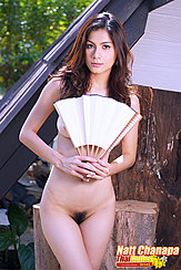 Holding Fan In Front Of Her Breasts Trimmed Pussy Hair