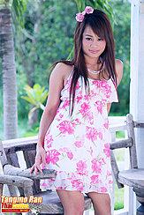 Standing Beside Wood Chair Wearing Dress